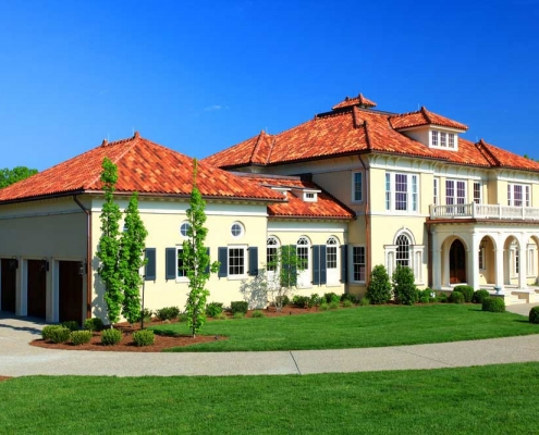 Spanish style terra cotta roof with copper gutters