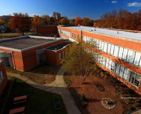 A rubberized modified asphalt sheet roof on a school